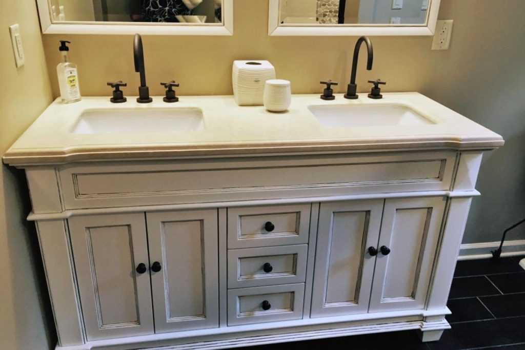 After: Dark antiquing accents were painted in the grooves and edges of the cabinet and mirrors to give them some interest and also disguise some less-than-perfect manufacturing details. New hardware upgrades the look as well.
