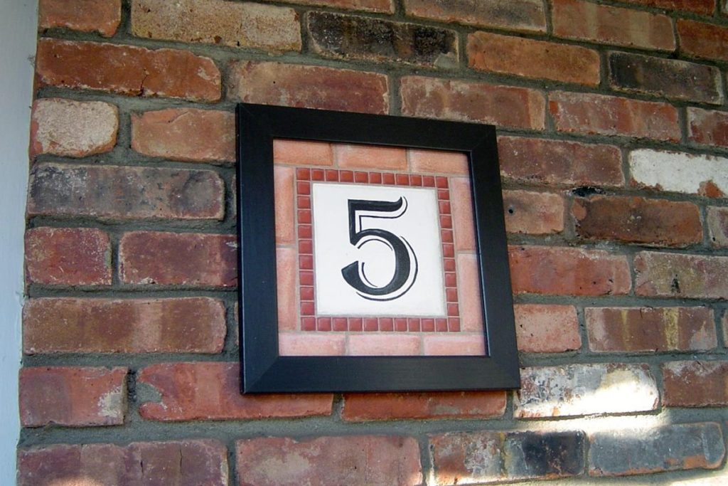 Framed faux tile address plaque.