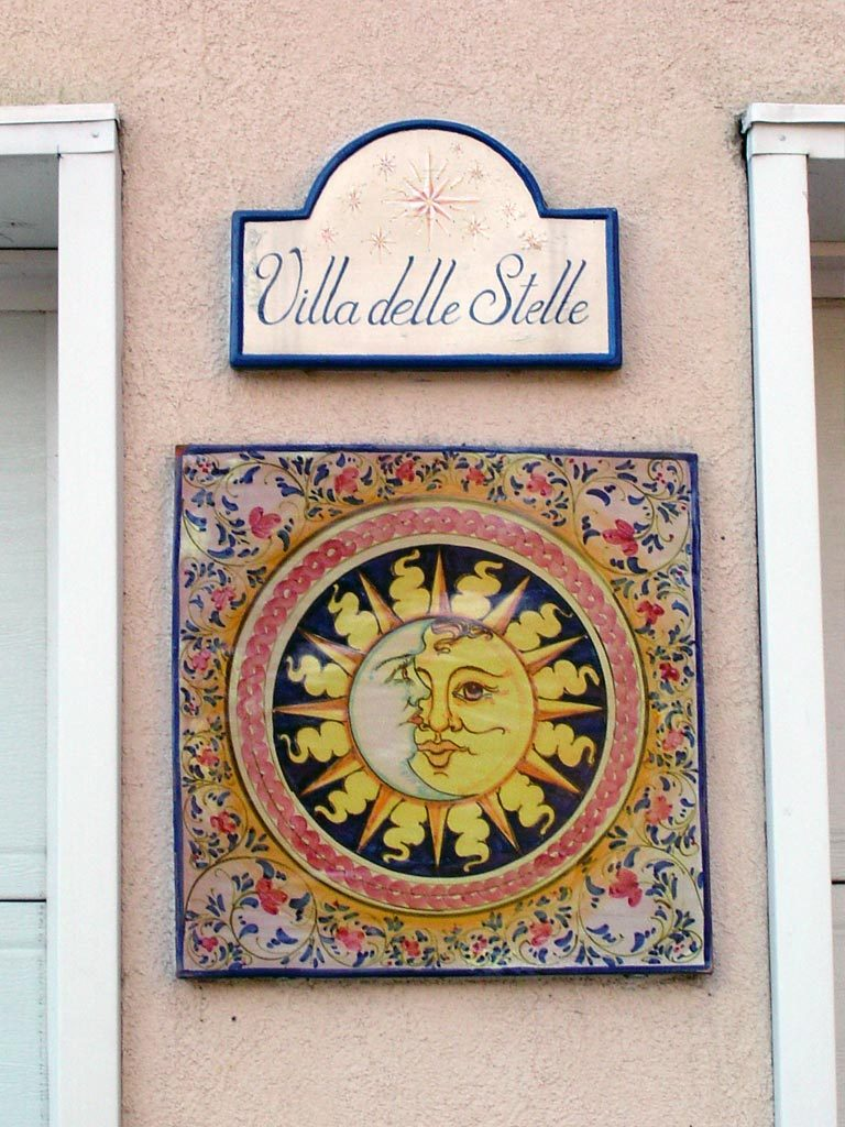 "Though not the address, this hand-painted plaque represents the house's name. Villa delle Stelle, the ""House of the Stars"" is situated high on a hill."