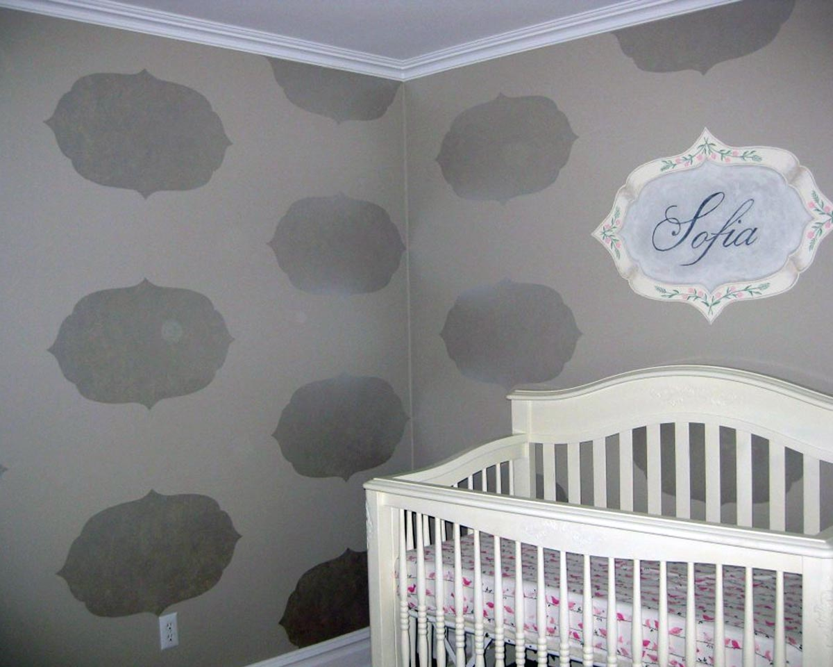 Name plaque and silhouette pattern in nursery