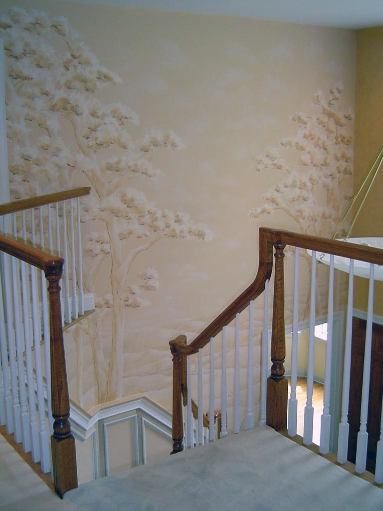 Monochromatic mural in two story foyer Landscape with trees.