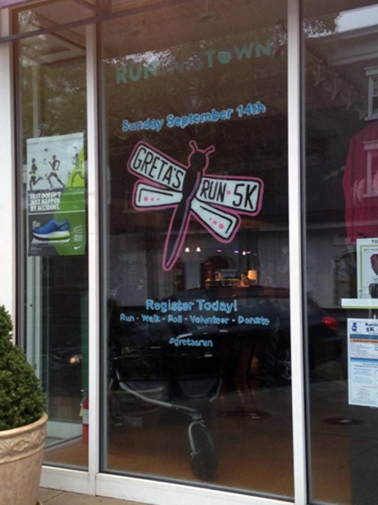 Storefront window design I painted for the 2014 Greta's Run.