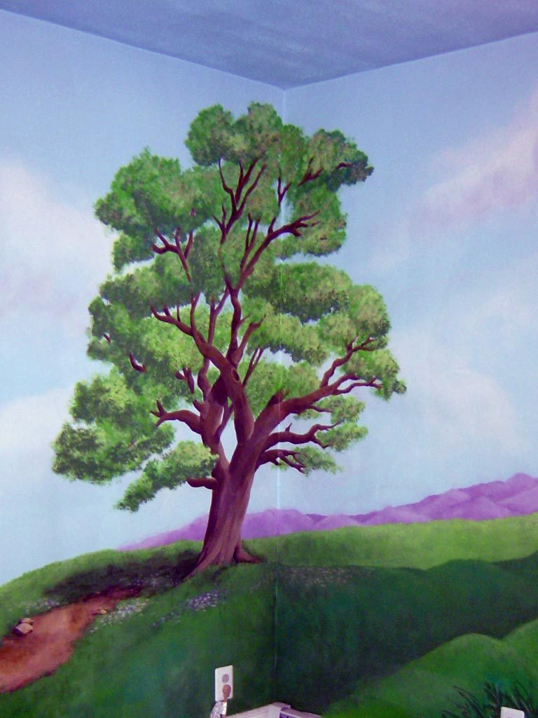 Tree as part of a full room landscape mural.