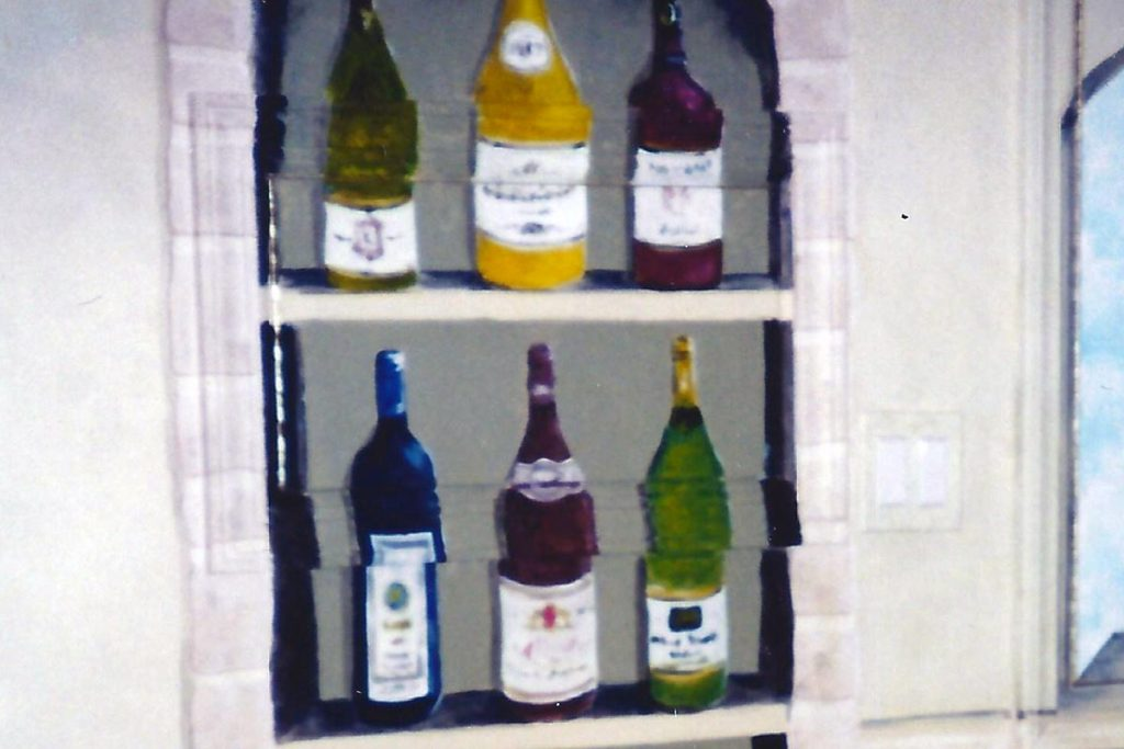 Small access panel became part of the wine cabinet. The wine cabinet disguises an access panel on the wall. The wine cabinet disguises a framed access panel on the wall.