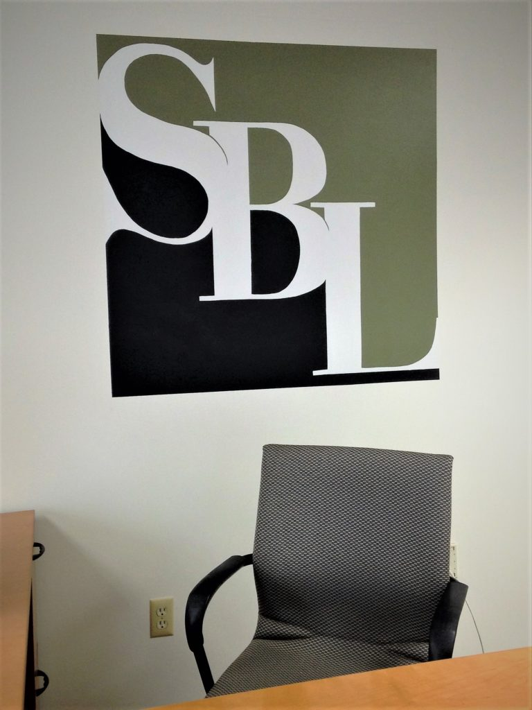 Hand painted company logo on office wall.