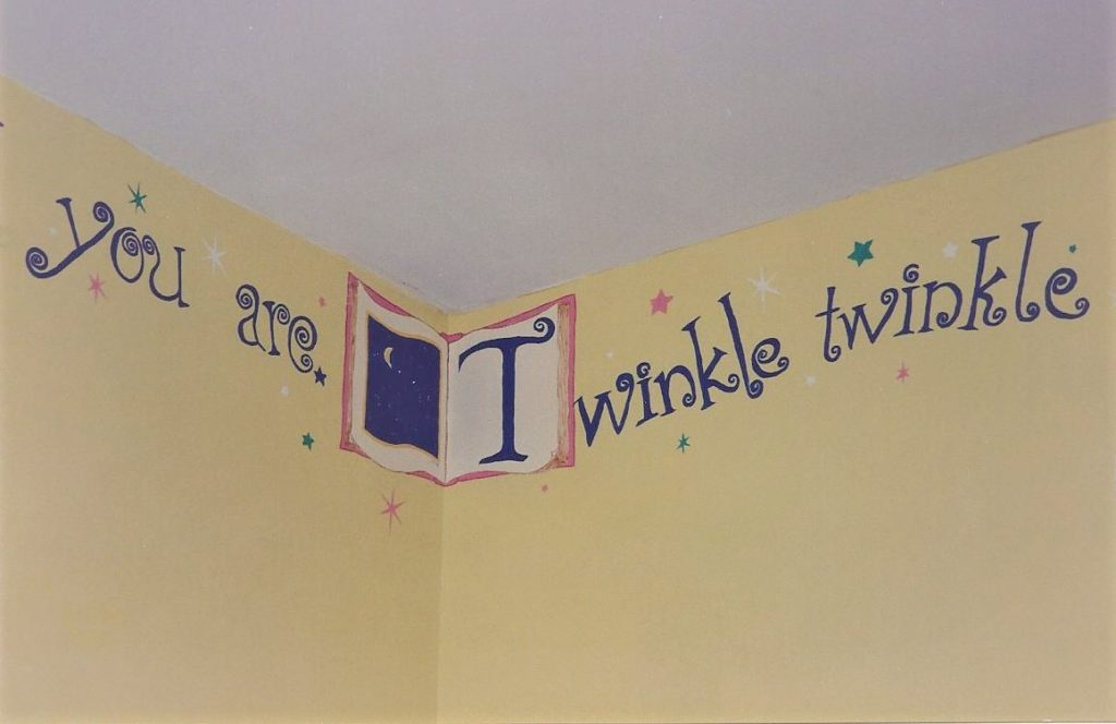 Twinkle little star rhyme painted around the top of nursery walls.