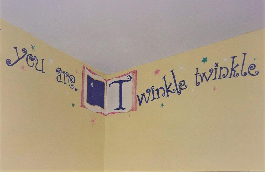 Twinkle little star rhyme painted around the top of nursery walls.