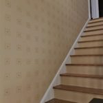 Custom designed and painted stencil pattern with rhinestone accent in hallway.