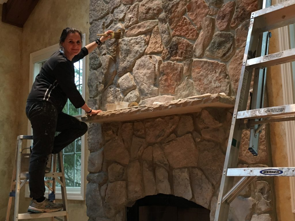 Painting color wash on fireplace stones