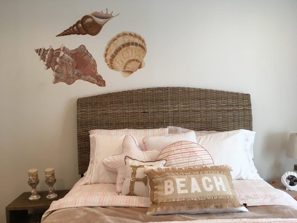 Hand painted sea shells on bedroom wall