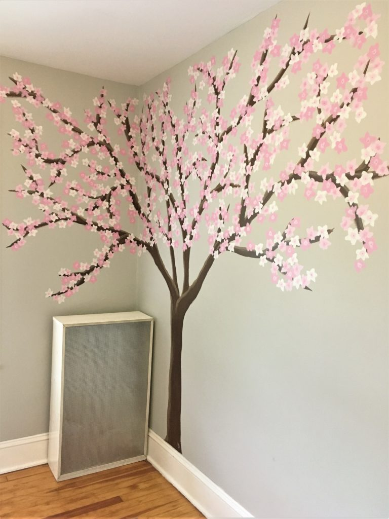 Simple freehand painting of cherry blossom tree in nursery.