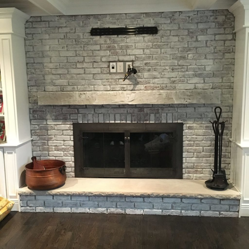 White colorwash on brick fireplace