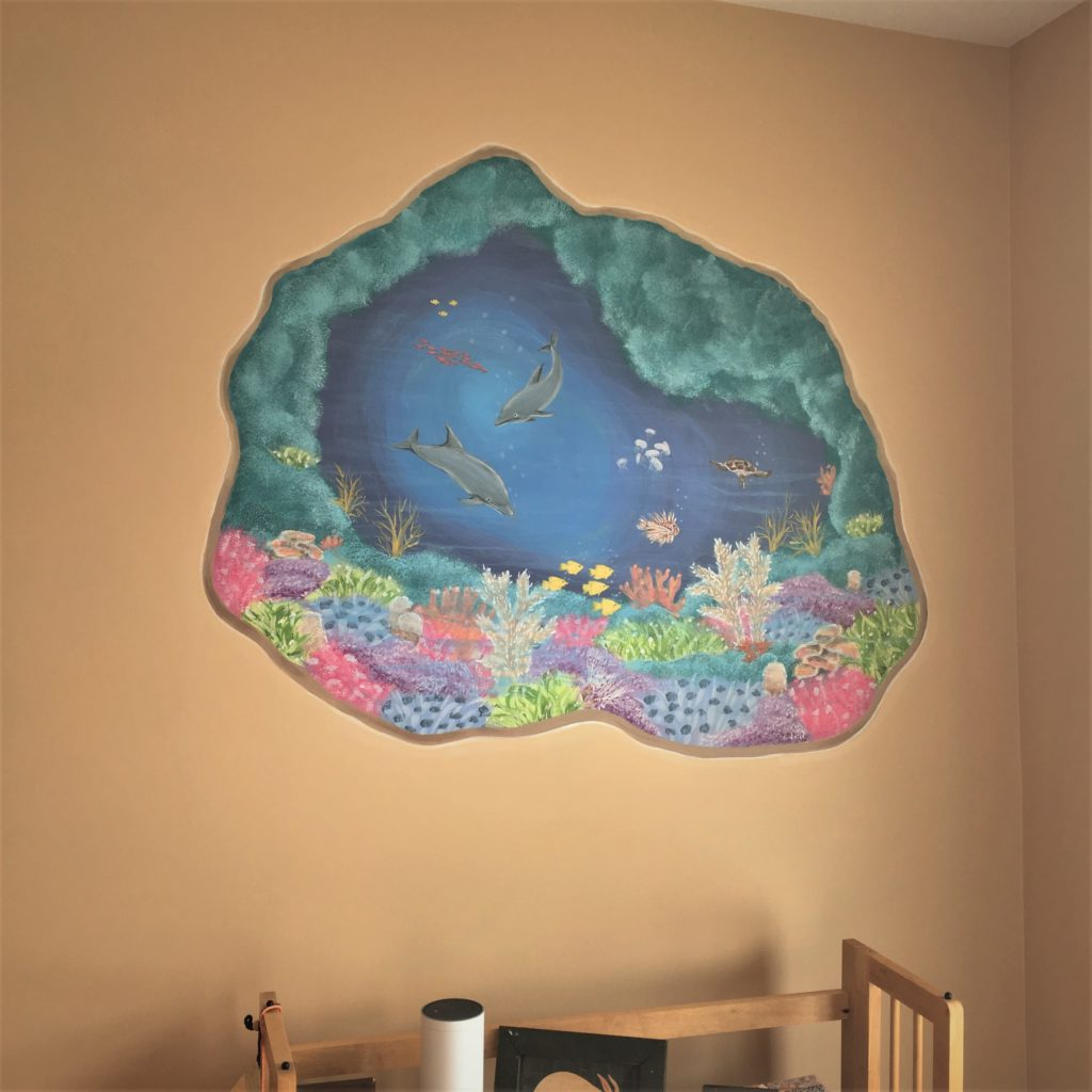 Smaller cut-away mural of underwater coral and ocean life