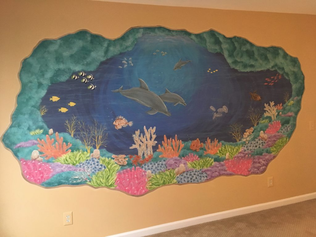 Large cut-away mural of underwater coral and ocean life