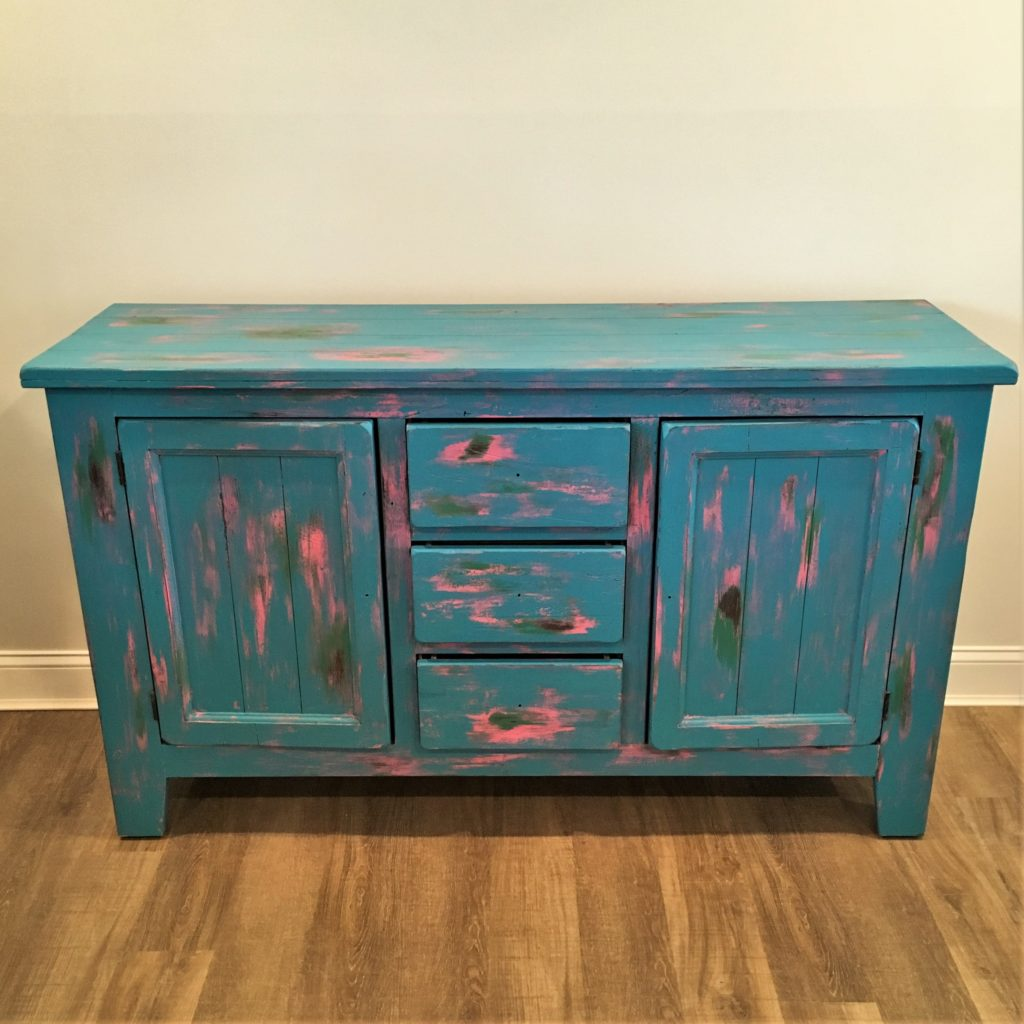 Buffet chest painted with a 4-color rubbed through distressed finish.