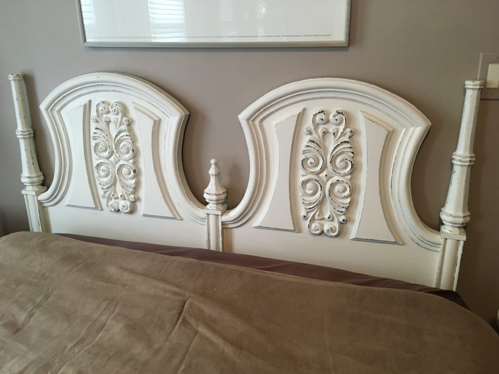 Painted and distressed mahogany headboard. Cream with rub-through to original wood.