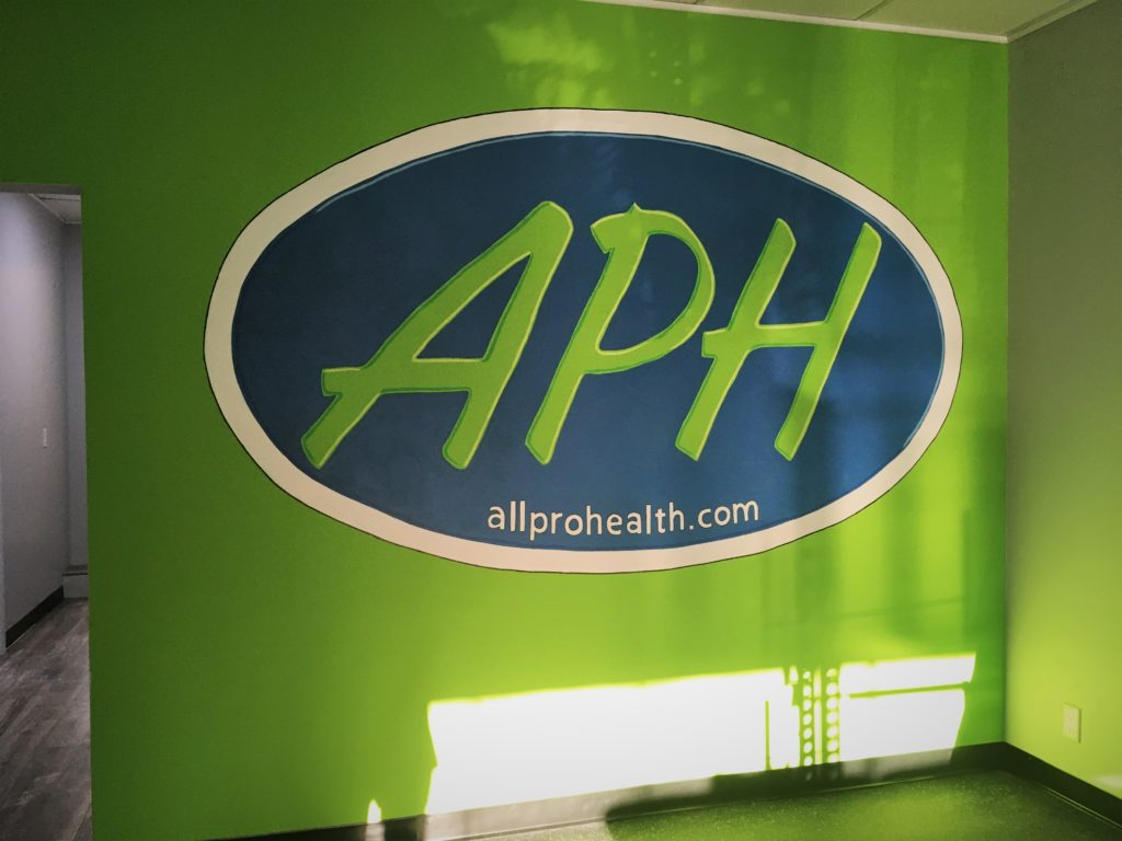 Hand painted logo in Physical therapy office. Appx 5' high x 9' wide