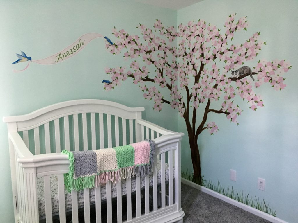Nursery mural featuring cherry blossom tree, baby's name, cat and birds