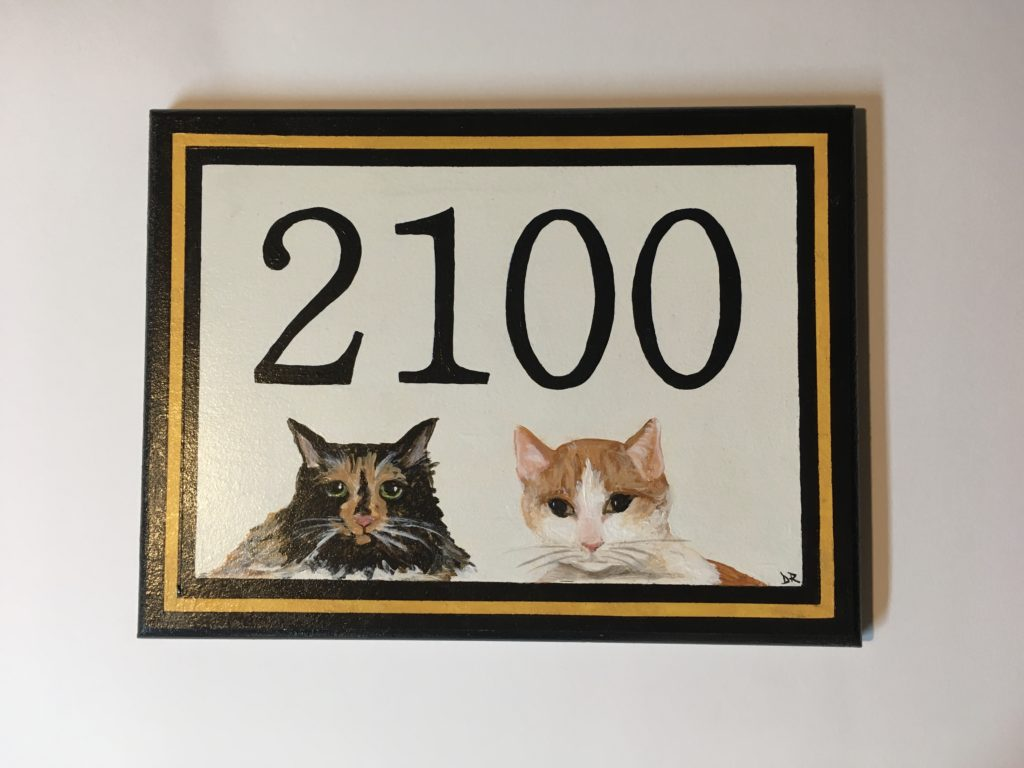 Hand painted address plaque featuring owner's cats illustrated. Acrylic on 9 x 12 wood.