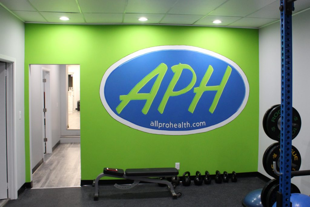 Hand painted logo in Physical therapy office. Appx 5\