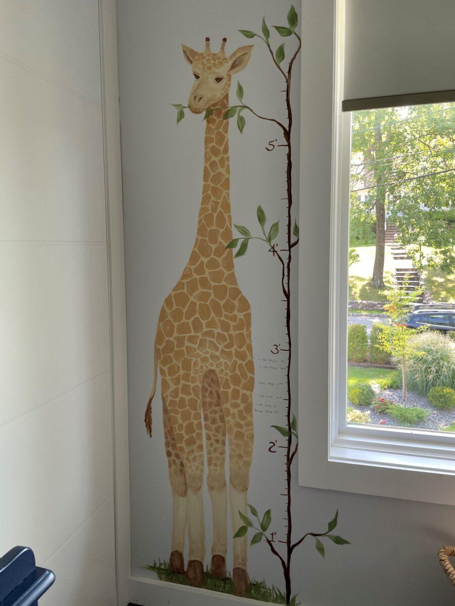Hand painted giraffe growth chart.