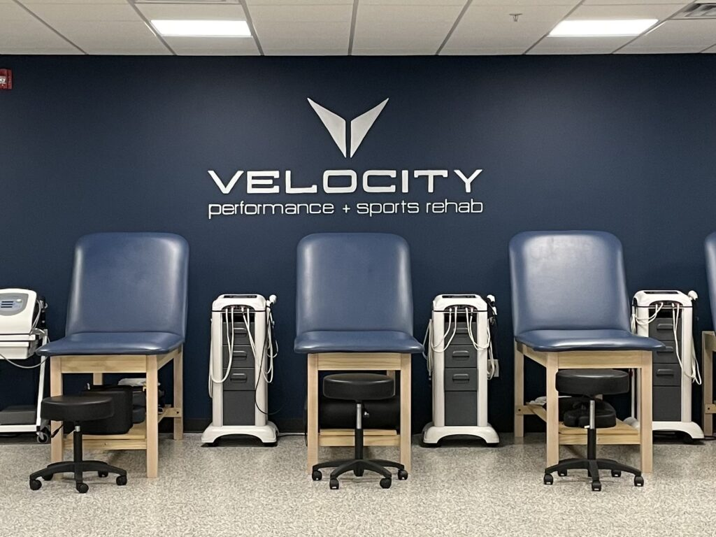 Brushed silver hand painted logo for sports therapy facility.