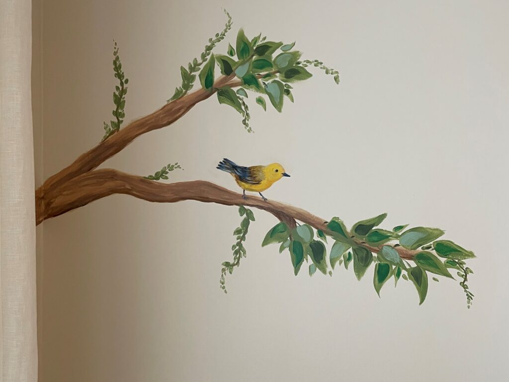 Leafy branch with bird painted as part of Dining Room mural.